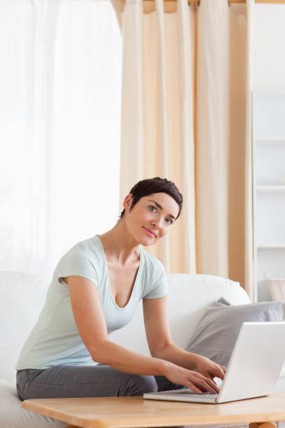 Portrait of a woman working with a laptop stock photo