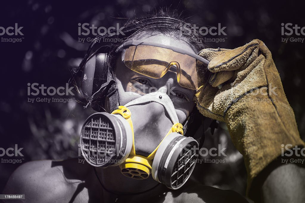 Portrait of a worker in protective clothing and gear. stock photo