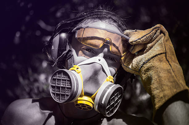 portrait of a worker in protective clothing and gear. - protective mask workwear stock pictures, royalty-free photos & images