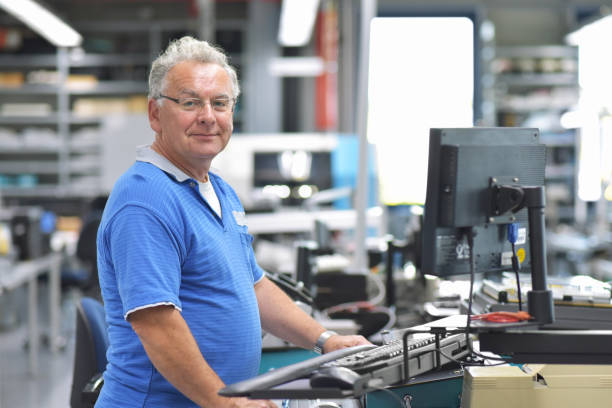 portrait of a worker in the engineering department of a factory for the production and construction of electronics stock photo