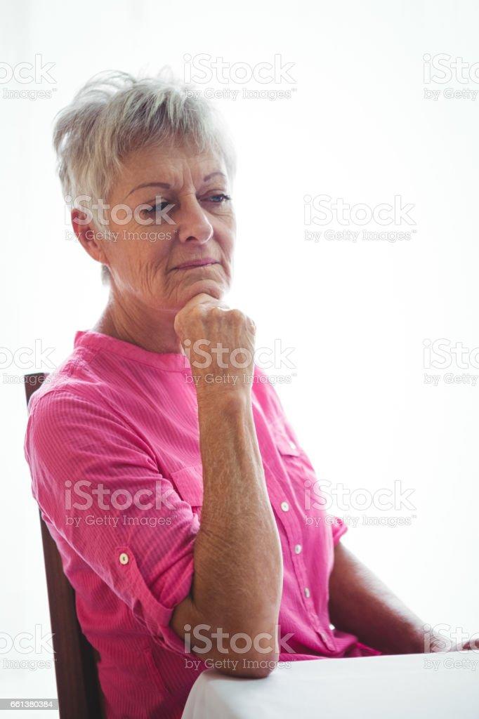 Portrait of a worried senior woman stock photo