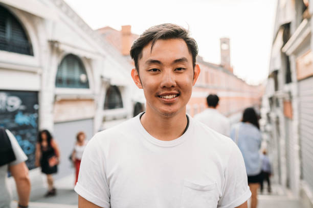 Portrait of a young adult asian man in Venice stock photo