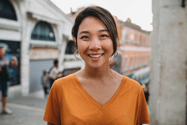 Portrait of a young adult asian woman in Venice stock photo