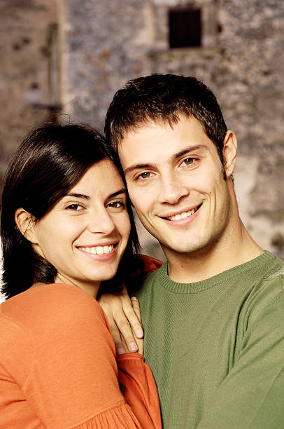 Portrait of a young adult couple smiling stock photo