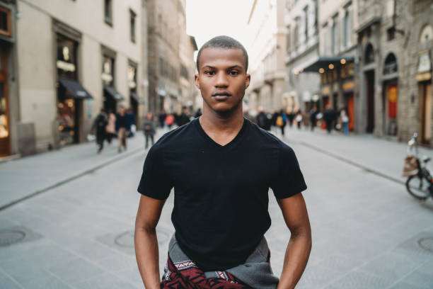 Portrait of a young adult man in the city stock photo