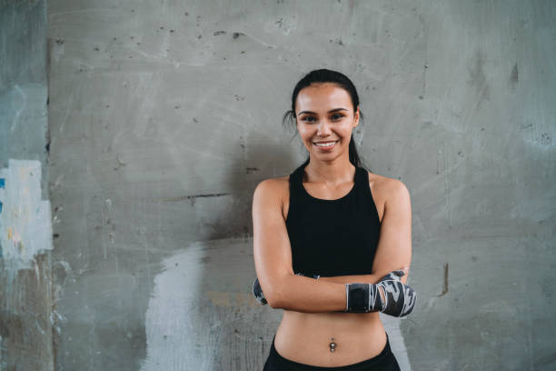 Portrait of a young adult muay thai fighter woman in the city stock photo