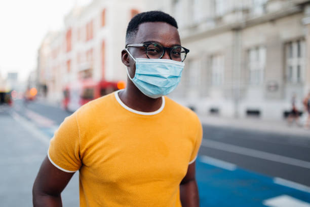 Portrait of a young African American man wearing a face mask stock photo