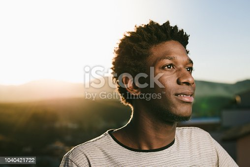 Portrait of a young brazilian man at sunset.