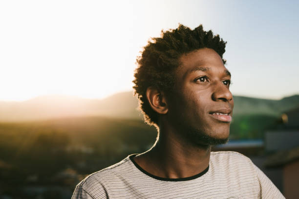 Portrait of a young African American Portrait of a young brazilian man at sunset. brazilian ethnicity stock pictures, royalty-free photos & images