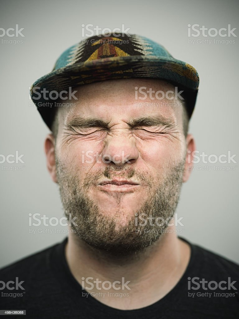 Portrait of a young american man with closed eyes stock photo