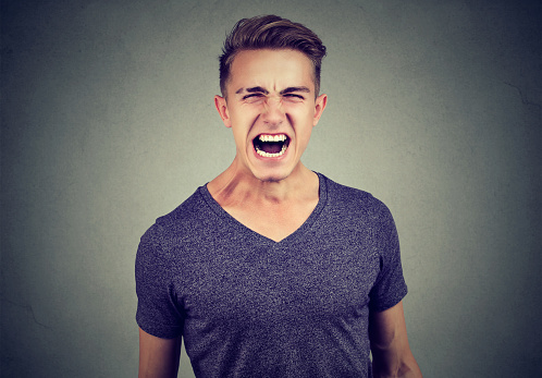 Portrait Of A Young Angry Man Screaming Stock Photo ...