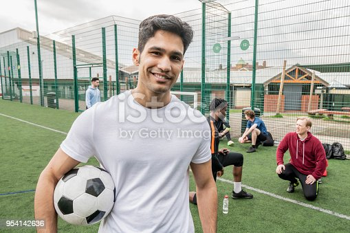 istock Portrait of a young asian footballer smiling 954142636