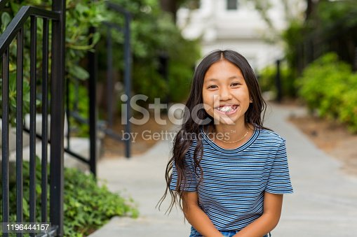 Portrait of a young happy Asian girl smiling.