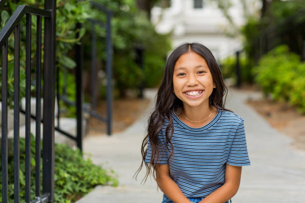 Portrait of a young Asian girl smiling outside. Portrait of a young happy Asian girl smiling. girls stock pictures, royalty-free photos & images