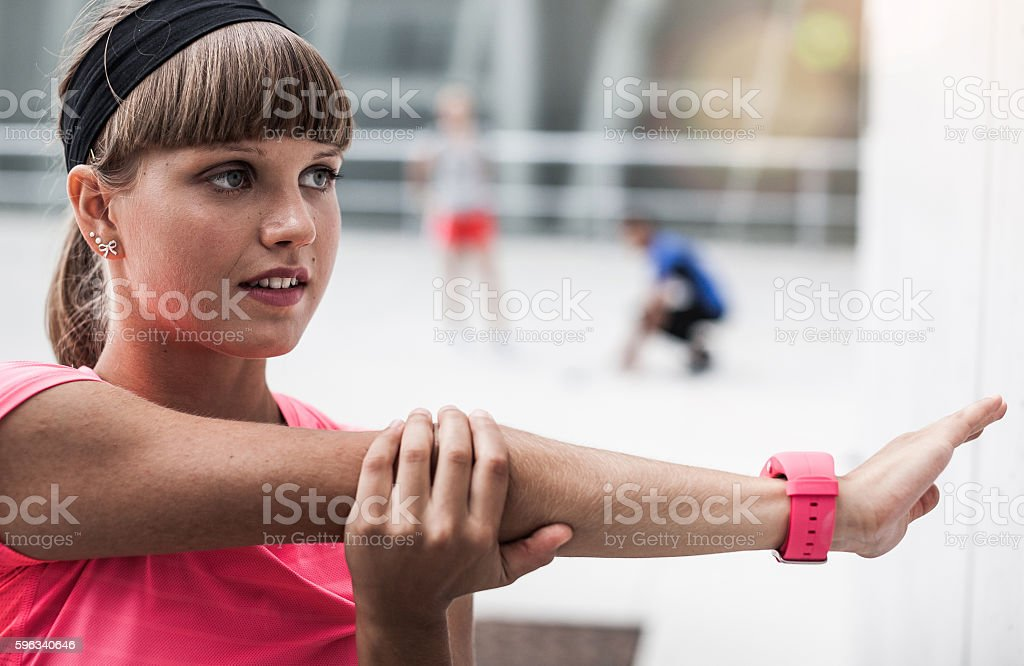 Portrait of a Young Athlete Stretching Outdoors royalty-free stock photo