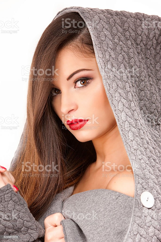 Portrait of a young attractive woman trying to keep warm. stock photo