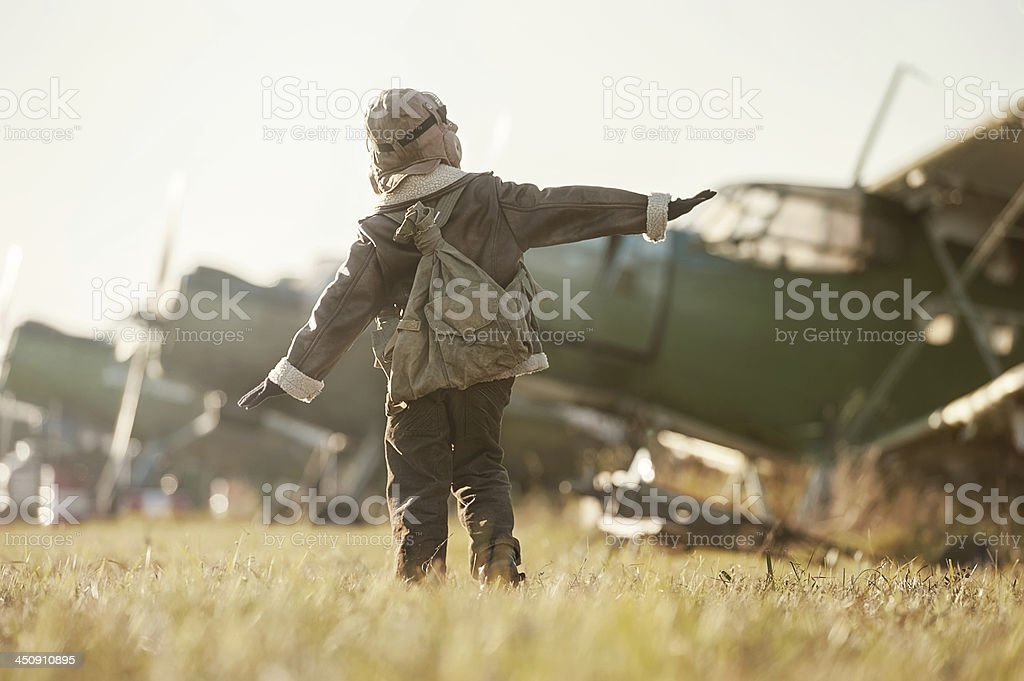 Portrait of a young aviator parked aircraft stock photo