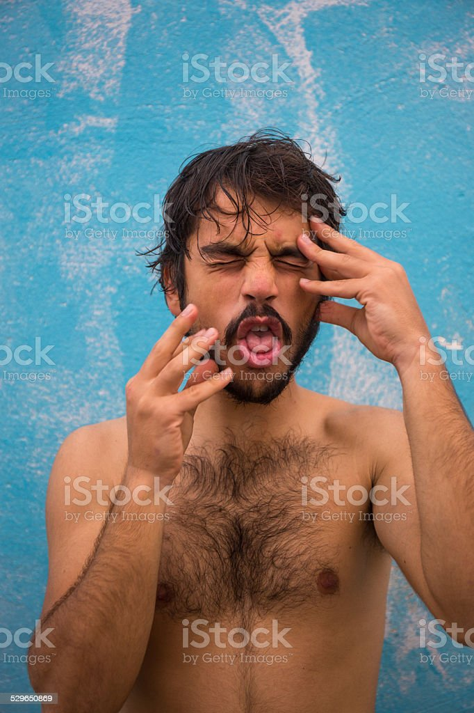 Portrait of a young bearded man shirtless stock photo