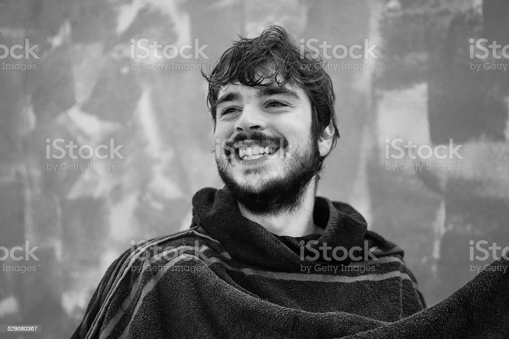 Portrait of a young bearded man that is smiling stock photo