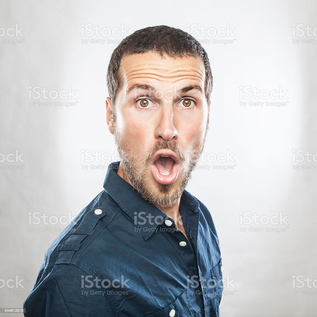 portrait of a young beautiful man surprised face expression stock photo