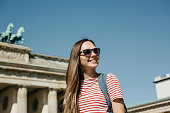 istock Portrait of a young beautiful positive smiling stylish tourist girl. 1150083456