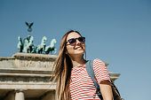 istock Portrait of a young beautiful positive smiling stylish tourist girl. 1150083598