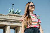 istock Portrait of a young beautiful positive smiling stylish tourist girl. 1150083786