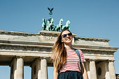 istock Portrait of a young beautiful positive smiling stylish tourist girl. 1150084046