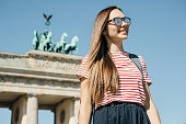 istock Portrait of a young beautiful positive smiling stylish tourist girl. 1150084048