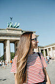 istock Portrait of a young beautiful positive smiling stylish tourist girl. 1150085042