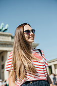 istock Portrait of a young beautiful positive smiling stylish tourist girl. 1150085168