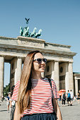 istock Portrait of a young beautiful positive smiling stylish tourist girl. 1150087181