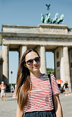 istock Portrait of a young beautiful positive smiling stylish tourist girl. 1150088742