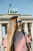 istock Portrait of a young beautiful positive smiling stylish tourist girl. 1150089879
