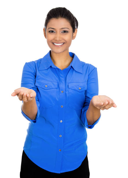 Portrait of a young beautiful smiling excited woman with raised up palms arms at you offering something stock photo