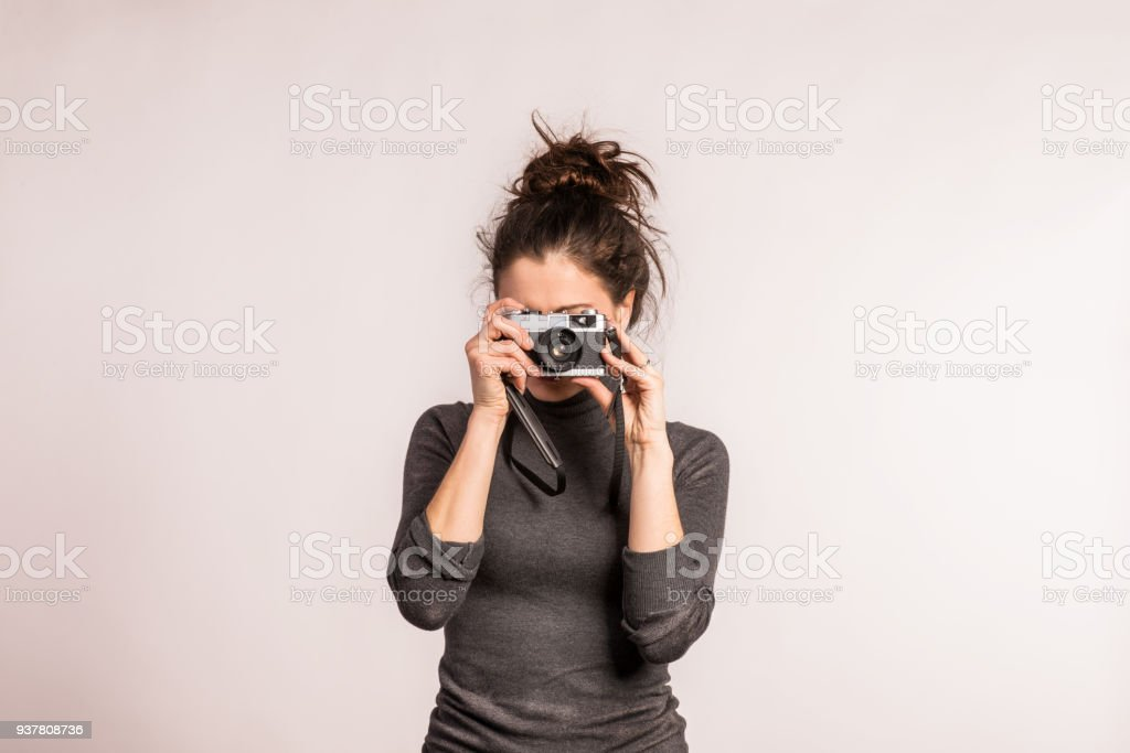 Portrait of a young beautiful woman in studio. stock photo
