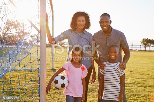 istock Portrait of a young black family during a football game 829627734