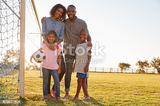istock Portrait of a young black family during a football game 829627804