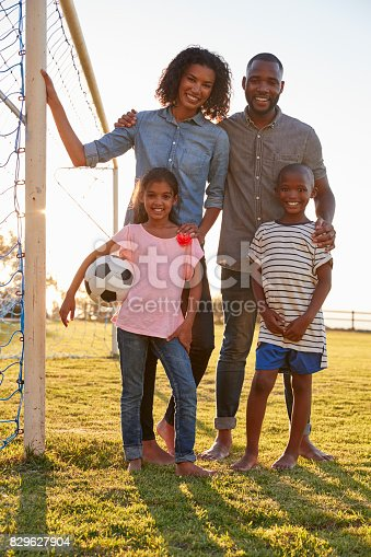 829627936istockphoto Portrait of a young black family next to a football goal 829627904