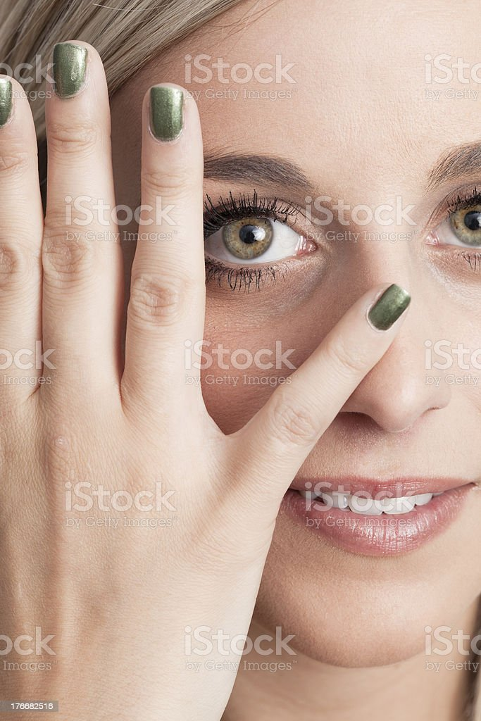 Portrait of a young blond woman convering one eye royalty-free stock photo