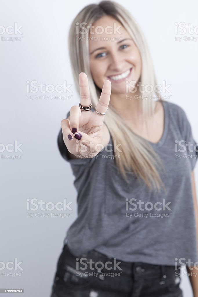 Portrait of a young blond woman smiling royalty-free stock photo