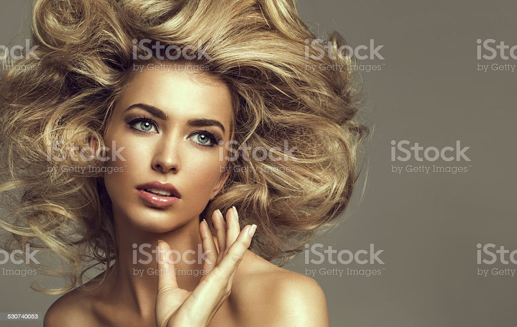Portrait of a young blond woman with beautiful hair stock photo