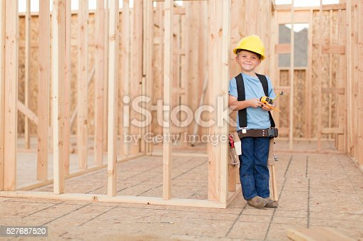 527687520 istock photo Portrait of a Young Boy dressed as Construction Worker 527687520