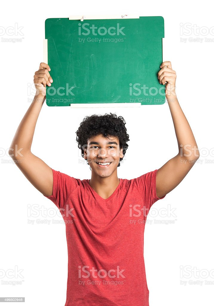 Portrait of a young boy holding a blackboard stock photo
