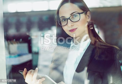 istock Portrait of a Young Buinesswoman Holding a Digital Tablet 629725718