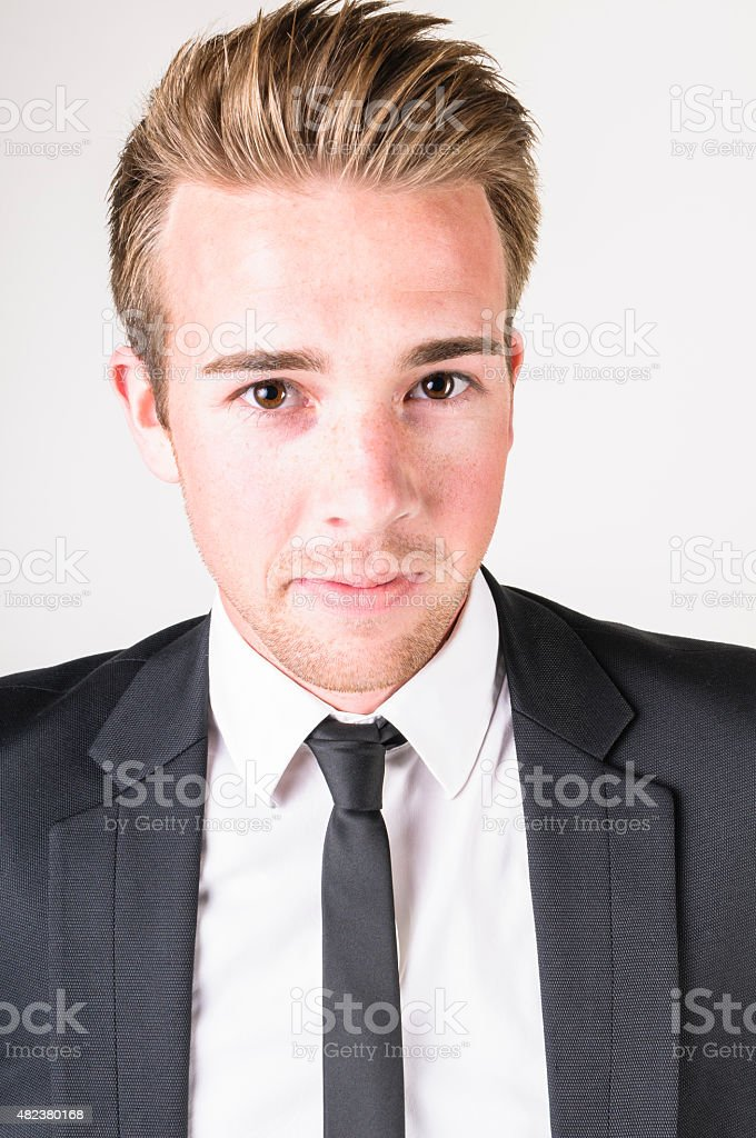portrait of a young businessman in a dark suit stock photo
