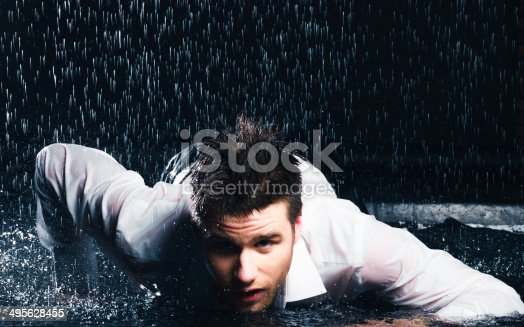 Portrait of a young businessman in the rain