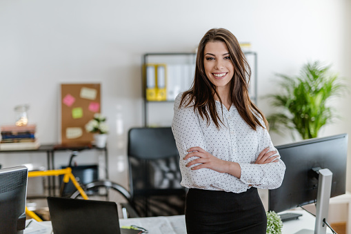 istock Portrait of a young businesswoman in her office 902220594