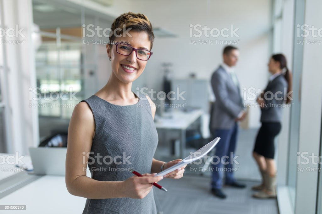 Portrait of a young businesswoman in the office stock photo