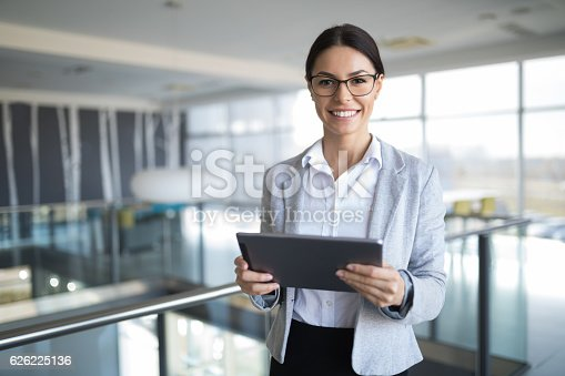 istock Portrait of a young businesswoman using digital tablet. 626225136